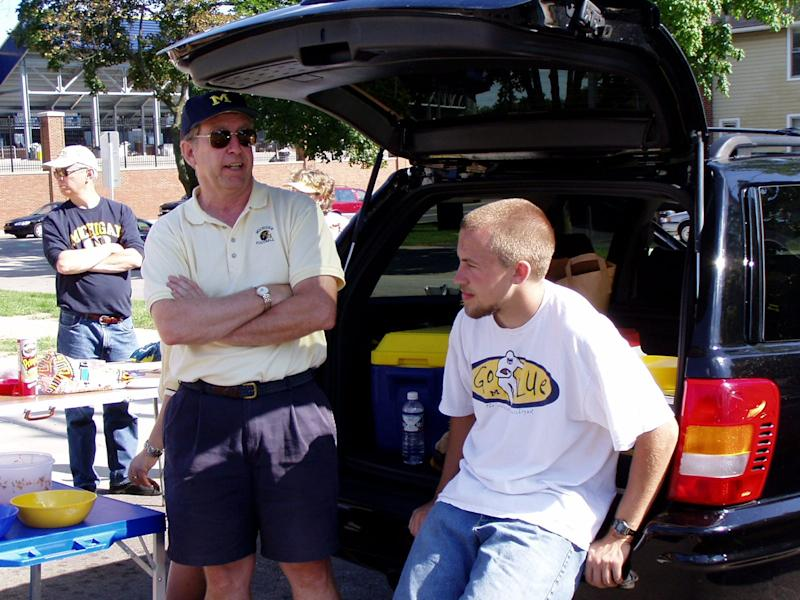 John Levinson (left) has been to every Michigan home game since the 1964 season.