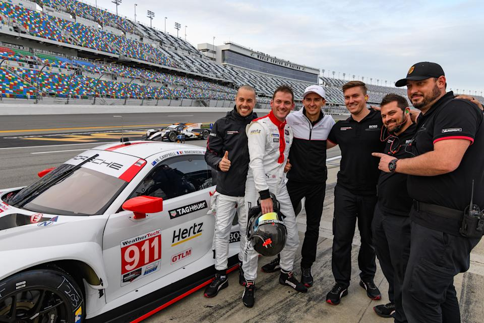 <em>Frederic Makowiecki (left) and Nick Tandy (second from left) with the No. 911 team at Daytona International Speedway earlier this season (Porsche).</em>