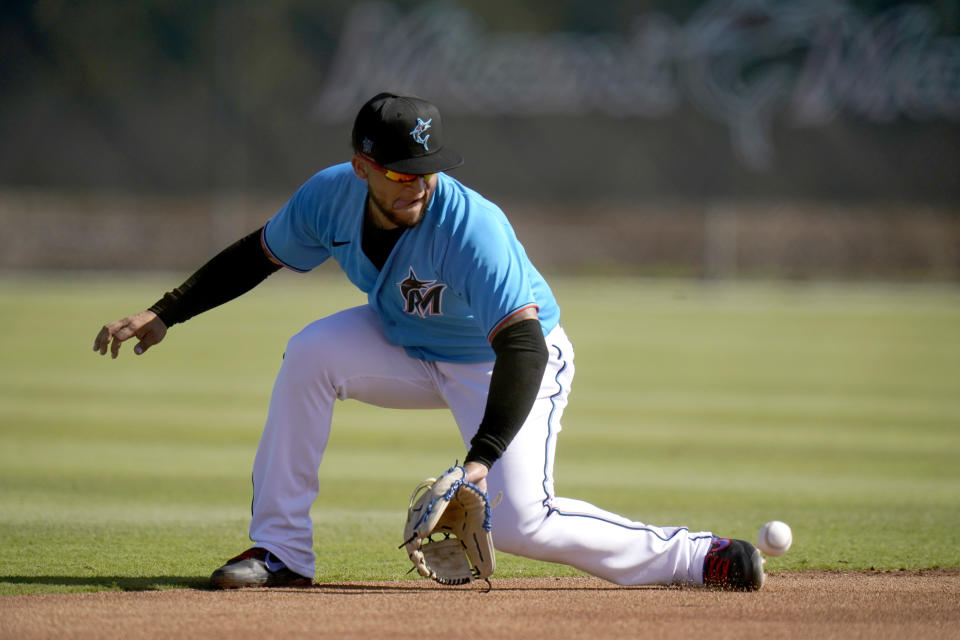 Miami Marlins infielder Isan Diaz handles a grounder during spring training baseball practice Friday, Feb. 26, 2021, in Jupiter, Fla. (AP Photo/Jeff Roberson)