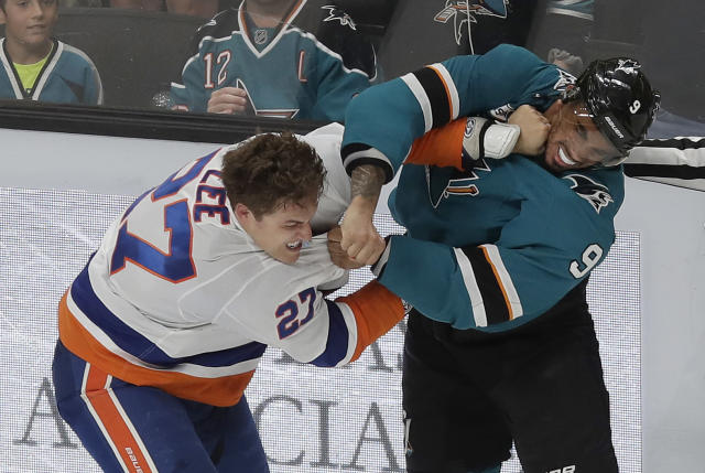 New York Islanders left wing Anders Lee, left, fights with San Jose Sharks left wing Evander Kane during the third period of an NHL hockey game in San Jose, Calif., Saturday, Oct. 20, 2018. The Sharks won 4-1. (AP Photo/Jeff Chiu)