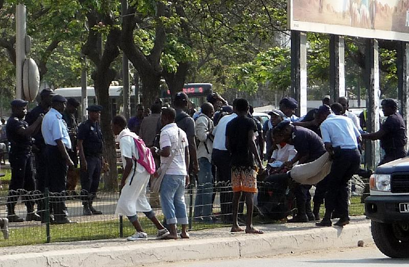 Angolan police officers arrest young people on September 19, 2013 at the Square of Independence in the center of Luanda, while they were calling for a demonstration against social injustices
