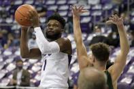 TCU guard Mike Miles (1) looks to the basket as North Dakota State guard Boden Skunberg defends during the second half of an NCAA college basketball game in Fort Worth, Texas, Tuesday, Dec. 22, 2020. (AP Photo/Tony Gutierrez)