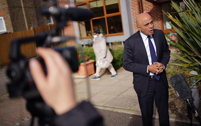 Sajid Javid speaks outside a GP in Forest Hill, south east London, following the announcement of his controversial new plan - PA