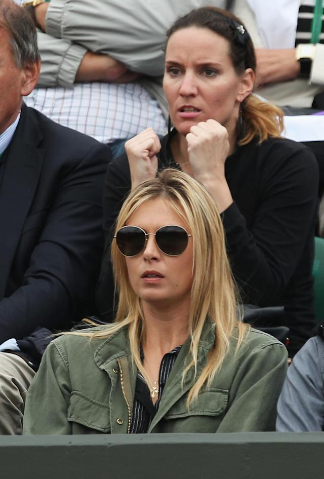 LONDON, ENGLAND - JUNE 28: Maria Sharapova of Russia the girlfriend of Grigor Dimitrov of Bulgaria waits for his rain delayed Gentlemen's Singles second round match against Greg Zemlja of Slovenia to continue on day five of the Wimbledon Lawn Tennis Championships at the All England Lawn Tennis and Croquet Club on June 28, 2013 in London, England. (Photo by Clive Brunskill/Getty Images)
