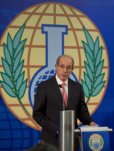 Director General Ahmet Uzumcu of the Organisation for the Prohibition of Chemical Weapons, OPCW, gives an update on the the chemical watchdog's verification and destruction mission in Syria during a press conference in The Hague, Netherlands, Wednesday Oct. 9, 2013. (AP Photo/Peter Dejong)