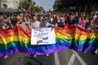 Participants march in the annual Gay Pride parade in Jerusalem, Thursday, June 3, 2021. Thousands of people marched through the streets of Jerusalem on Thursday in the city's annual gay pride parade. (AP Photo/Ariel Schalit)
