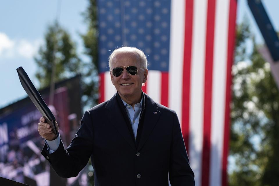 Democratic presidential nominee Joe Biden addresses supporters at a campaign stop in North Carolina on 18 October. (AFP via Getty Images)