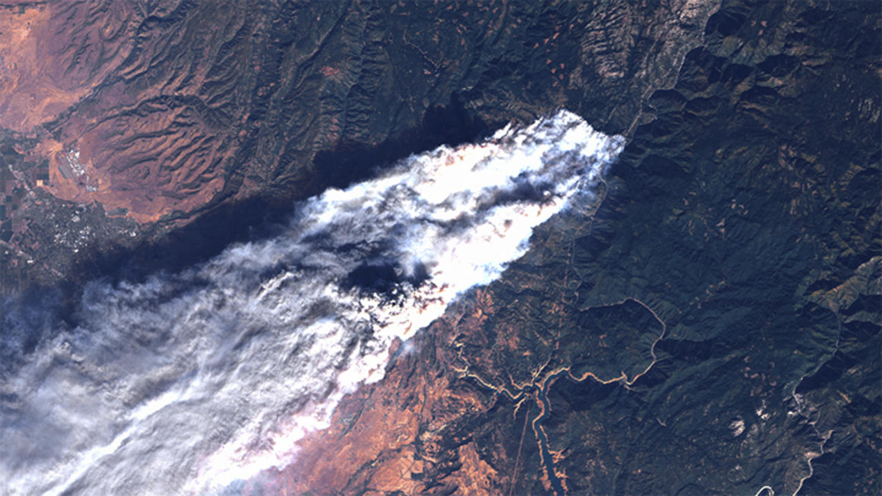 This Thursday, Nov. 8, 2018, satellite image provided by geology professor Jeff Chambers at the University of California, Berkeley, shows a true-color image captured by Landsat 8, showing the full extent of the actively burning area of the Camp Fire about four hours after it started over the town of Paradise, Calif. The primary burn front was growing at a rate of approximately 3 mph (5 kph). (Jeff Chambers/University of California, Berkeley via AP)