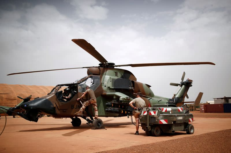 FILE PHOTO: French soldiers work on a Tiger attack helicopter at the Operational Desert Plateform Camp (PfOD) during the Operation Barkhane in Gao