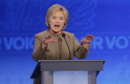 Democratic U.S. presidential candidate Clinton responds to a question about the potential use of U.S. ground troops to fight Islamic State during the Democratic presidential candidates debate at St. Anselm College in Manchester