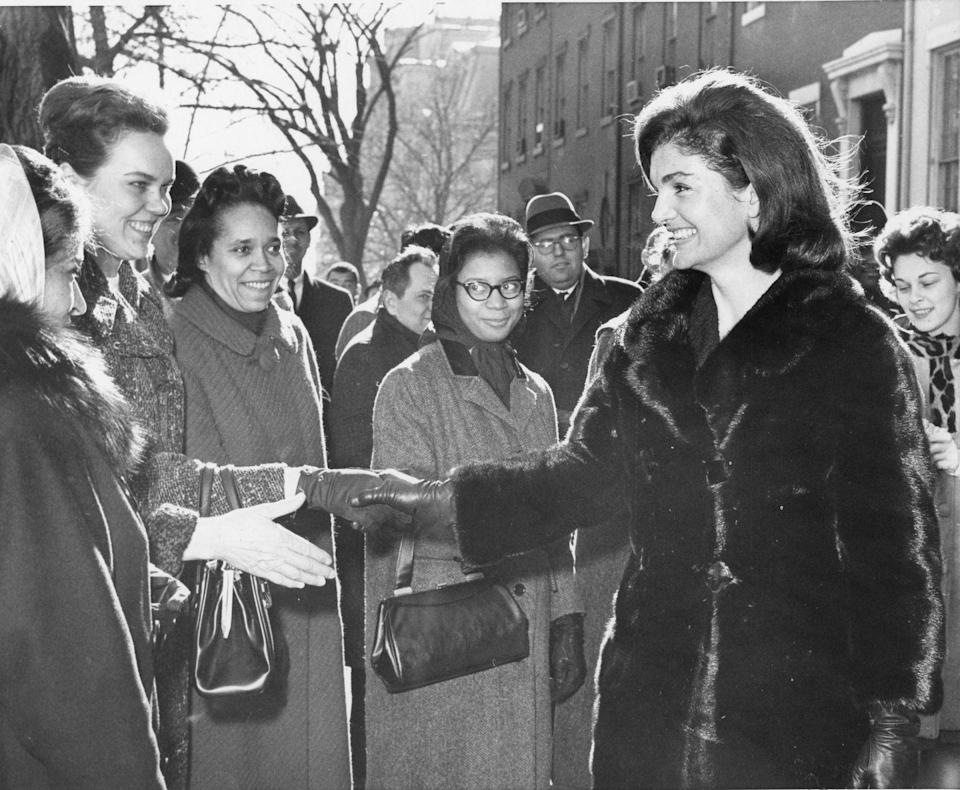 <p>Jackie Kennedy greets well-wishers in Washington D.C. following the assassination of her husband. </p>