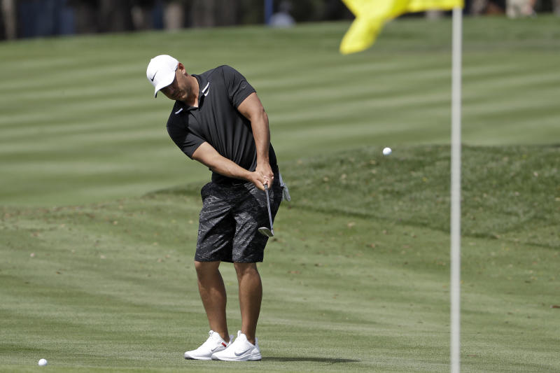 Brooks Koepka hits to the 16th green during a practice round for The Players Championship golf tournament Wednesday, March 11, 2020, in Ponte Vedra Beach, Fla. (AP Photo/Chris O'Meara)