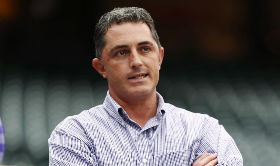 FILE - Colorado Rockies general manager Jeff Bridich looks on as the Rockies take batting practice before hosting the Washington Nationals in a baseball game in Denver, in this Monday, April 24, 2017, file photo. Jeff Bridich is stepping down as general manager of the Colorado Rockies, ending a tumultuous tenure that included two playoff appearances and a falling out with Nolan Arenado that ultimately led to the star third baseman's offseason trade. The Rockies announced Monday, April 26, 2021, the decision was a mutual agreement with Bridich, who was in his seventh season as GM. (AP Photo/David Zalubowski, File)