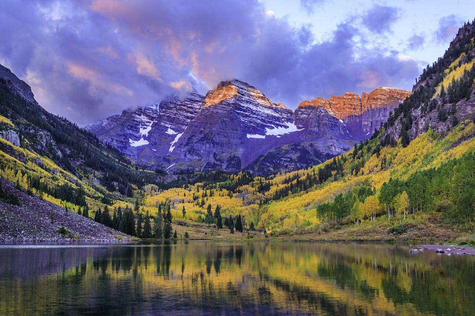 """<p><strong>Where to go:</strong> The Maroon Bells — two 14,000-foot peaks in the Elk Mountains — draw photographers from near and far, but this spot is easily accessible (10 miles!) from Aspen. </p><p><strong>When to go: </strong>Late October</p><p><a class=""""link rapid-noclick-resp"""" href=""""https://go.redirectingat.com?id=74968X1596630&url=https%3A%2F%2Fwww.tripadvisor.com%2FHotels-g29141-Aspen_Colorado-Hotels.html&sref=https%3A%2F%2Fwww.redbookmag.com%2Flife%2Fg34045856%2Ffall-colors%2F"""" rel=""""nofollow noopener"""" target=""""_blank"""" data-ylk=""""slk:FIND A HOTEL"""">FIND A HOTEL</a></p><p><strong>RELATED: <a href=""""https://www.goodhousekeeping.com/life/travel/a26415468/best-last-minute-travel-deals-apps/"""" rel=""""nofollow noopener"""" target=""""_blank"""" data-ylk=""""slk:The Best Sites and Apps for Finding Last-Minute Travel Deals"""" class=""""link rapid-noclick-resp"""">The Best Sites and Apps for Finding Last-Minute Travel Deals</a></strong></p>"""