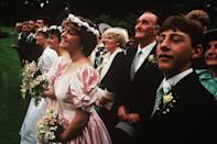 <p>Guess what's back? Pink. Flower crowns also made a mark around this time, as seen on this bridesmaid, who's lucky enough to be wearing both trends.</p>