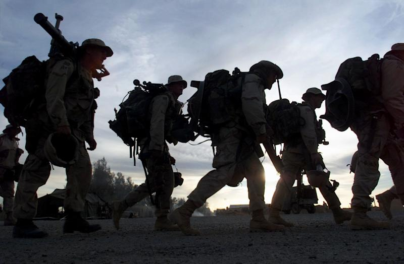 Marines boarding transport helicopters in Kandahar, Afghanistan, in this Dec. 31, 2001 file photo.