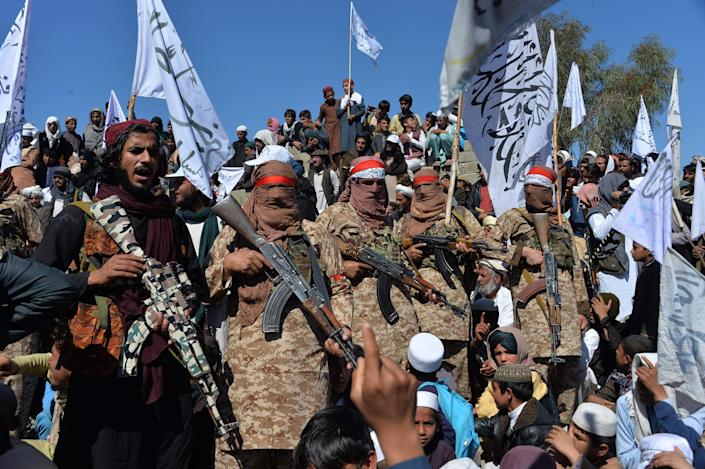 Image: Afghan Taliban militants and villagers attend a gathering as they celebrate the peace deal and their victory in the Afghan conflict on U.S. in Afghanistan (Noorullah Shirzada / AFP - Getty Images file)