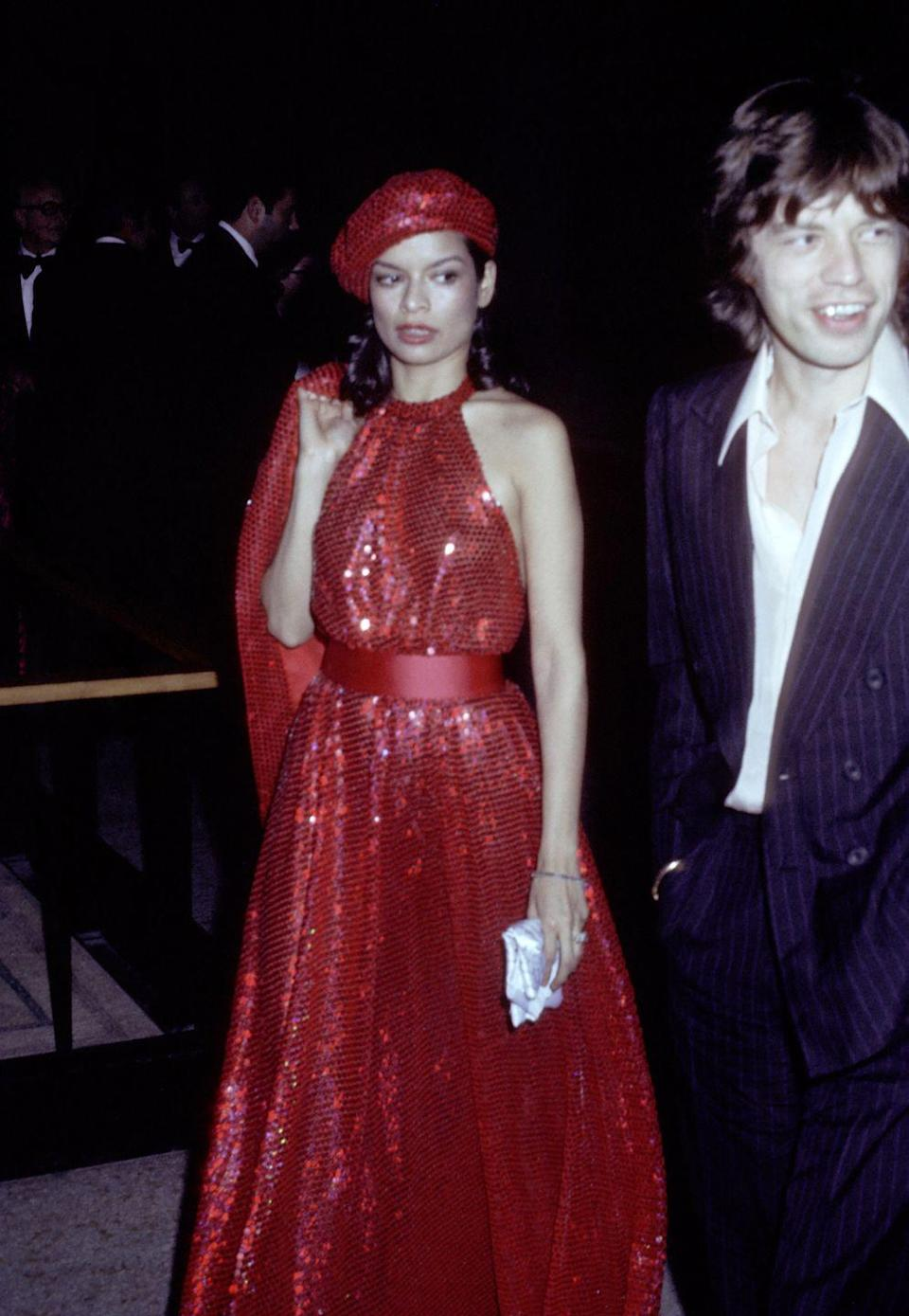 <p>Halter neck, belted waist, sequins—Bianca Jagger couldn't be trendier if she tried. With the late '70s came the years of Studio 54 and disco, which meant lamé fabric and breezy dresses. </p>
