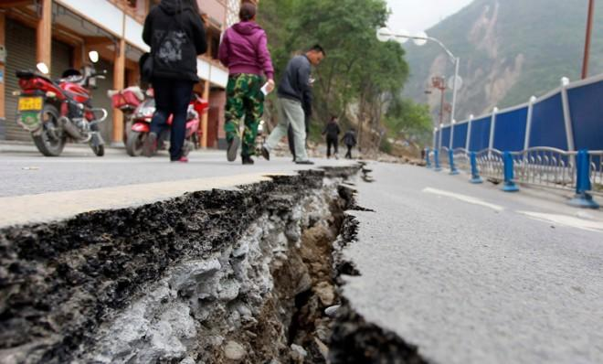 A crack in the road caused by Saturday's earthquake in Baoxing county, Sichuan province.