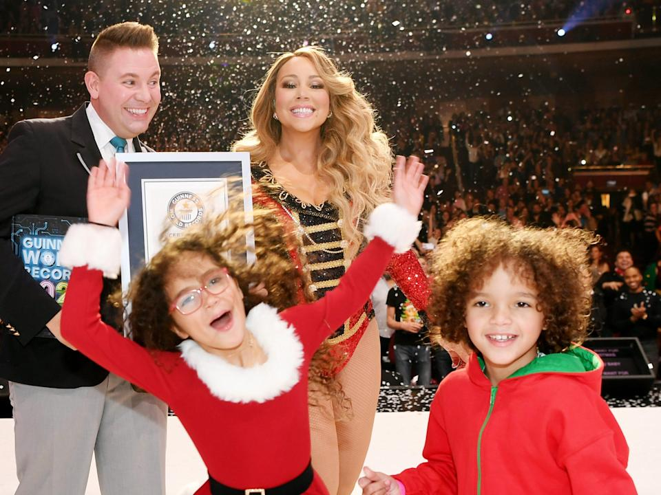 Mariah Carey with her twins Monroe and Moroccan at an ice skating rink
