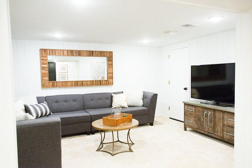 """<p>If your basement is plagued by drab brown wood paneling, it may be easier than you think to achieve a modern look. A fresh coat of white paint will make your space appear brighter and more inviting, while the wood paneling can add texture. </p><p><strong>See more at <a href=""""http://www.almahomesmn.com/blog/thehighlandshouse-basement-reveal/"""" rel=""""nofollow noopener"""" target=""""_blank"""" data-ylk=""""slk:Alma Homes"""" class=""""link rapid-noclick-resp"""">Alma Homes</a>. </strong></p><p><a class=""""link rapid-noclick-resp"""" href=""""https://go.redirectingat.com?id=74968X1596630&url=https%3A%2F%2Fwww.walmart.com%2Fip%2FColorPlace-ULTRA-Interior-Paint-Primer-White-Flat-1-Quart%2F102942997&sref=https%3A%2F%2Fwww.redbookmag.com%2Fhome%2Fg36061437%2Fbasement-ideas%2F"""" rel=""""nofollow noopener"""" target=""""_blank"""" data-ylk=""""slk:SHOP WHITE PAINT"""">SHOP WHITE PAINT</a></p>"""