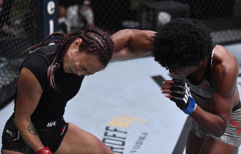 LAS VEGAS, NEVADA - SEPTEMBER 12: (R-L) Angela Hill punches Michelle Waterson in a strawweight fight during the UFC Fight Night event at UFC APEX on September 12, 2020 in Las Vegas, Nevada. (Photo by Jeff Bottari/Zuffa LLC)