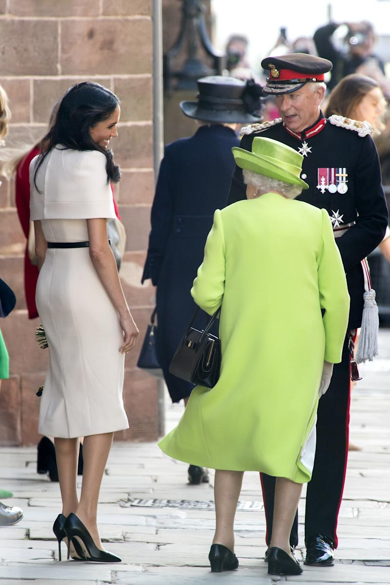 CHESTER, ENGLAND - JUNE 14: Meghan, Duchess of Sussex and Queen Elizabeth II share a smile as they speak with the Lord Lieutenant as they leave Chester Town Hall on June 14, 2018 in Chester, England. Meghan Markle married Prince Harry last month to become Meghan, Duchess of Sussex. This is her first engagement with the Queen. During the visit the pair opened a road bridge in Widnes, visited The Storyhouse in Chester followed by the Town Hall. (Photo by Anthony Devlin/Getty Images)