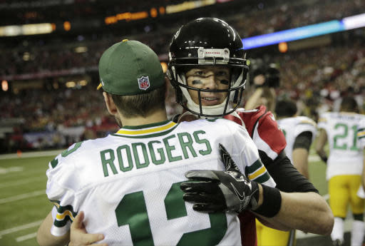 FILE - In this Jan. 22, 2017, file photo, Green Bay Packers' Aaron Rodgers hugs Atlanta Falcons' Matt Ryan before the NFL football NFC championship game, in Atlanta. The fortunes of the Atlanta Falcons and Green Bay Packers have changed less than two years after they met in the NFC title game. Theyre each trying to avoid losing records when the teams meet on Sunday at Lambeau Field. (AP Photo/David Goldman, File)
