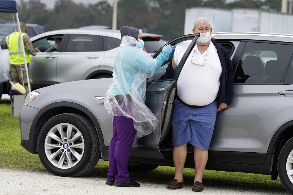 A man gets the coronavirus vaccine at an outdoor vaccination site at Lakewood Ranch Wednesday, Feb. 17, 2021, in Bradenton, Fla. (AP Photo/Chris O'Meara)