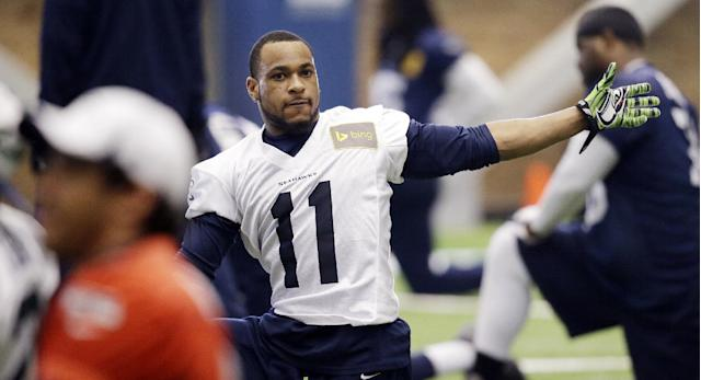 Seattle Seahawks wide receiver Percy Harvin stretches during NFL football practice Wednesday, Jan. 22, 2014, in Renton, Wash. The Seahawks play the Denver Broncos in the Super Bowl on Feb. 2. (AP Photo/Elaine Thompson)