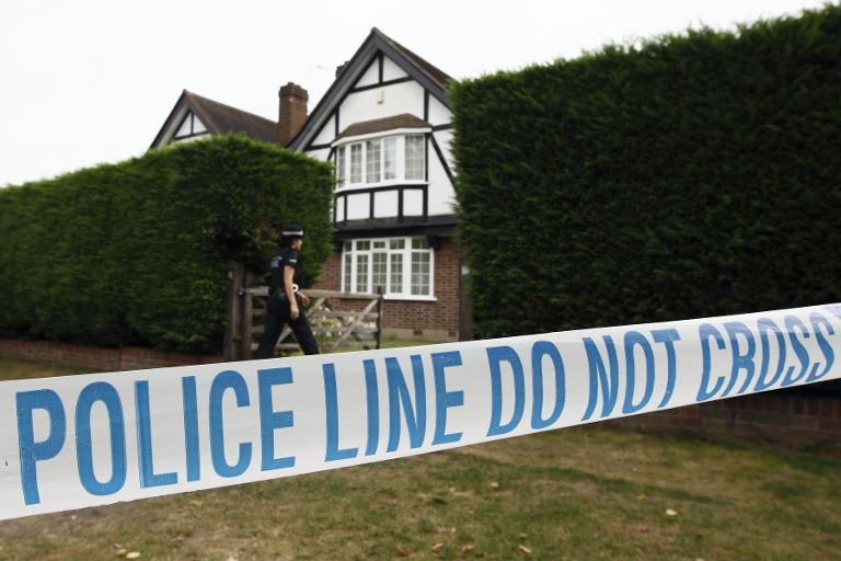 British police stand outside the home of Saad and Iqbal al-Hilli in Claygate, in Surrey, south-east England, on September 14, 2012