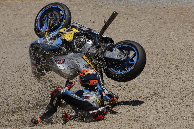 <p>MotoGP rider Tito Rabat of Spain falls from his bike at the Spanish Motorcycle Grand Prix at the Jerez racetrack in Jerez de la Frontera, Spain, May 7, 2017. (Miguel Morenatti/AP) </p>