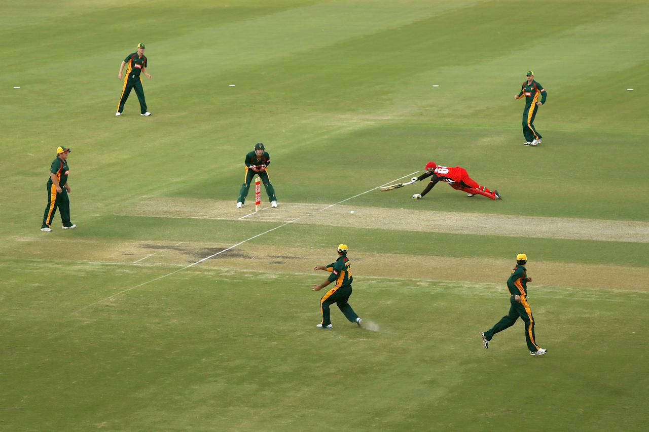 ADELAIDE, AUSTRALIA - OCTOBER 14: Phillip Hughes of the Redbacks makes his ground in time not to be run out during the Ryobi one day cup match between the South Australian Redbacks and the Tasmanian Tigers at Adelaide Oval on October 14, 2012 in Adelaide, Australia.  (Photo by Morne de Klerk/Getty Images)