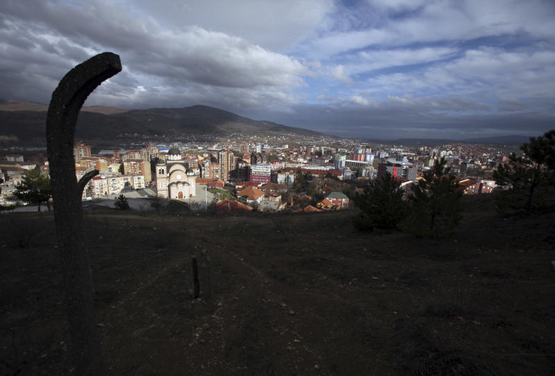 In this photo taken Friday, March 29, 2013, a general view of the ethnically divided town of Mitrovica, Kosovo. Mitrovica, a former mining center in northern Kosovo, was sharply split into Serb and Albanian parts at the end of the Kosovo war in 1999. The town's fate has come into renewed focus as officials from Serbia and Kosovo meet in Brussels on Tuesday in hopes of reaching an agreement that could pave the way for reuniting the divided city. (AP Photo/Darko Vojinovic)