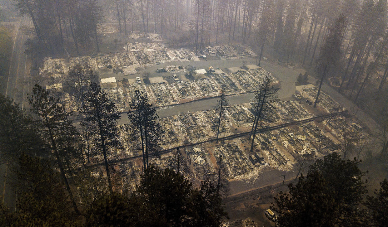 Residences leveled by the wildfire line a neighborhood in Paradise, Calif., on Nov. 15. (Photo: Noah Berger/AP)