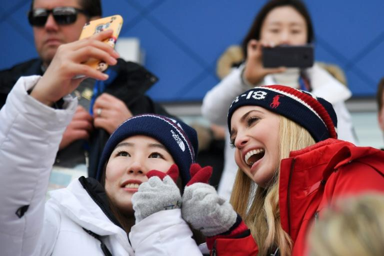 Ivanka (R) is attending the closing ceremony of the Winter Olympics