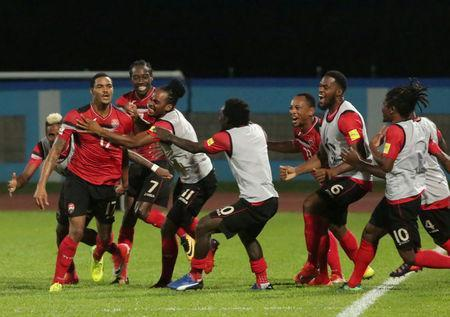 Trinidad's Alvin Jones celebrates his goal with team mates. REUTERS/Andrea de Silva