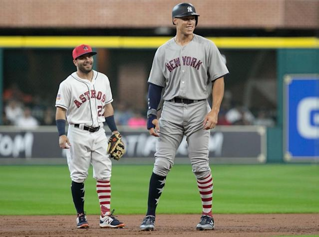 AL MVP Jose Altuve (left) stands alongside runner-up Aaron Judge during the 2017 season. (AP)