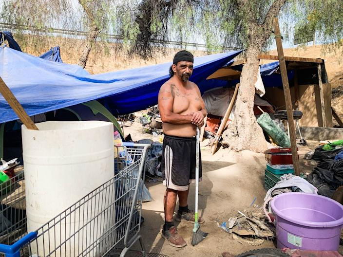 """With stores and churches shut down in Fresno County, Juan Gallardo has been cut off from the critical support system he'd developed for life on the streets. """"It's hard to get food on your table right now; you have to hustle even more,"""" he says. <span class=""""copyright"""">(Angela Hart / Kaiser Health News)</span>"""