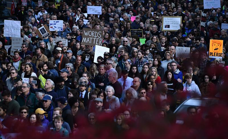 Thousands of people march through Pittsburgh to protest President Donald Trump's visit just days after 11 people were killed in a shooting at Tree of Life synagogue. (BRENDAN SMIALOWSKI via Getty Images)