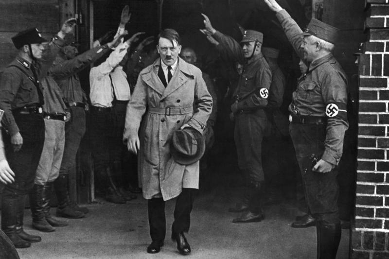 """FILE - In this Dec. 5, 1931 file photo Adolf Hitler, leader of the National Socialists, leaves the party's Munich, Germany headquarters. On Friday, June 12, 2020, The Associated Press reported on stories circulating online incorrectly asserting that Hitler defunded the police and installed his own enforcers. Gavriel D. Rosenfeld, a historian and history professor at Fairfield University says, """"Let's just say the Nazis did everything BUT defund the police,"""" noting that Nazis made the police one of the chief recipients of state financial support aside from military spending. (AP Photo/File)"""