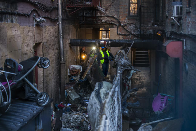 <p>Police and workers inspect the building Friday, Dec. 29, 2017, where the deadliest residential fire in decades broke out Thursday in the Bronx, New York. (Photo: Andres Kudacki/AP) </p>