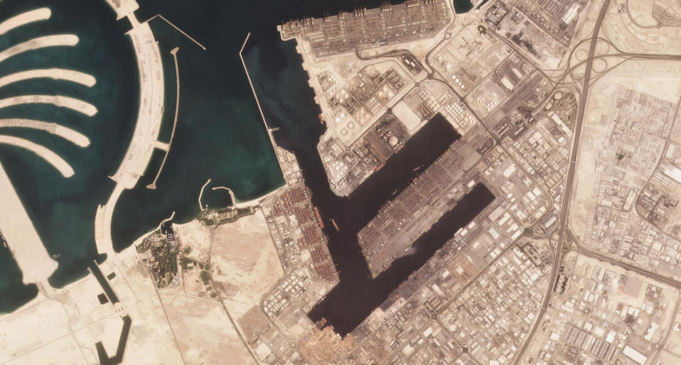 In this satellite photo shot by Planet Labs Inc., the Jebel Ali Port is seen early Wednesday, July 7, 2021, in Dubai, United Arab Emirates. A fiery explosion erupted on a container ship anchored in Dubai at one of the world's largest ports later Wednesday, authorities said, sending tremors across the commercial hub of the United Arab Emirates. (Planet Labs Inc. via AP)