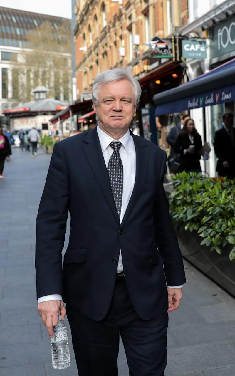 David Davis walks through the Leicester Square district after giving a television interview in London - Credit: Bloomberg
