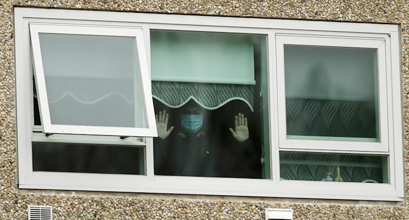 A person wearing a urgical mask inside of a building during lockdown in Melbourne