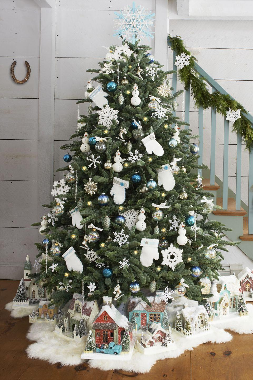 <p>Since your mantle is already covered with your extensive Santa Claus collection, use your beloved Christmas village as a makeshift tree skirt — but you'll probably need to move it out of the way before Santa unloads the presents. </p>