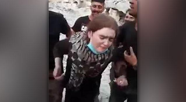 Video emerged of the teen's arrest where jubilant crowds can be heard cheering amid her distraught cries at Mosul. Source: LiveLeak