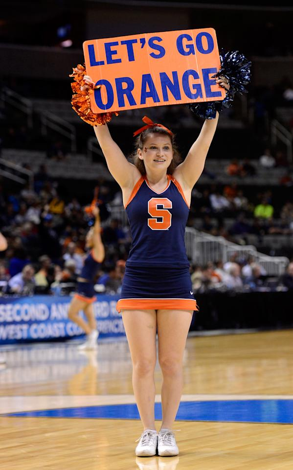 A Syracuse Orange cheerleader performs on the court during a game stoppage in the first half against the Montana Grizzlies during the second round of the 2013 NCAA Men's Basketball Tournament at HP Pavilion on March 21, 2013 in San Jose, California.