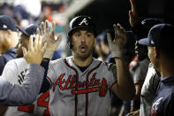 Atlanta Braves' Matt Joyce high-fives teammates in the dugout after scoring on Dansby Swanson's double during the fourth inning of the team's baseball game against the Washington Nationals, Friday, Sept. 13, 2019, in Washington. (AP Photo/Patrick Semansky)