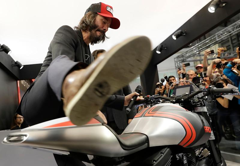 Actor Keanu Reeves mounts on a Arch 1S during the unveiling of his Arch motorcycles at the EICMA exhibition motorcycling fair in Milan, Italy, Wednesday, Nov. 8, 2017. (AP Photo/Luca Bruno)